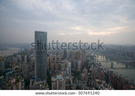 High angle view of skyscrapers in chongqing at sunset - stock photo