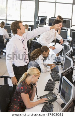 wide angle view busy design office. high angle view of stock traders at work wide busy design office i