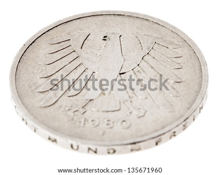 High angle view of the reverse (tails) side of a a 5 Deutsche Mark (DM) coin minted in 1980. Depicted is the German coat of arms - the German eagle. Isolated on white background. - stock photo