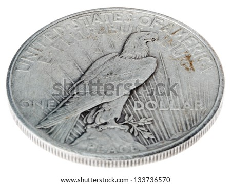 High angle view of the reverse (tails) side of a silver dollar minted in 1925, known by the name 'Peace Dollar'. This design memorializes the peace that followed WWI. Isolated on white background. - stock photo