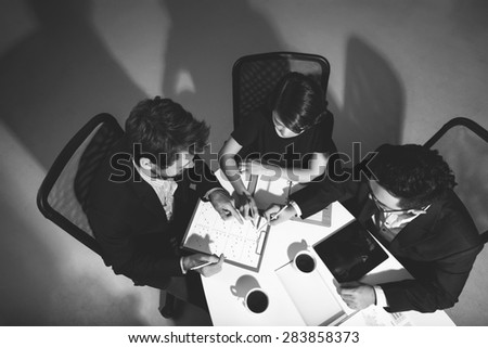 High angle view of three managers at meeting