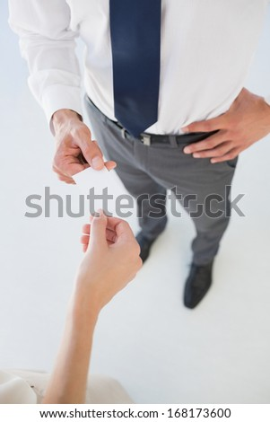 High angle view of two executives exchanging business card