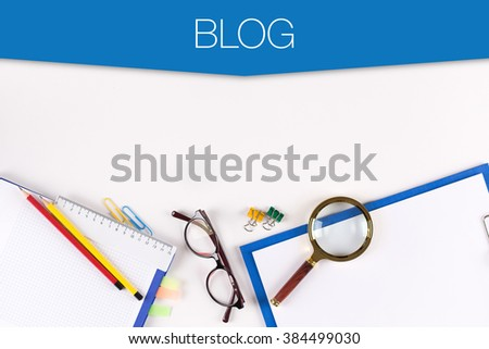 High Angle View of Various Office Supplies on Desk with a word BLOG - stock photo