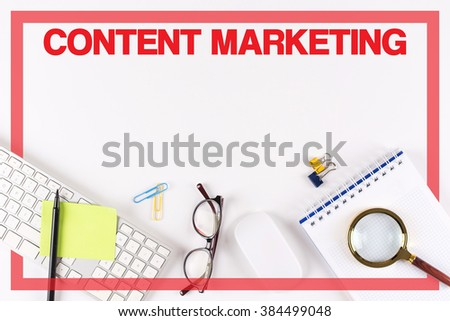 High Angle View of Various Office Supplies on Desk with a word CONTENT MARKETING - stock photo