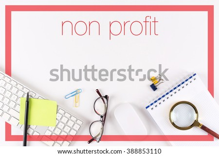 High angle view of various office supplies on desk with a word Non Profit