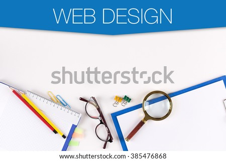 High Angle View of Various Office Supplies on Desk with a word WEB DESIGN - stock photo