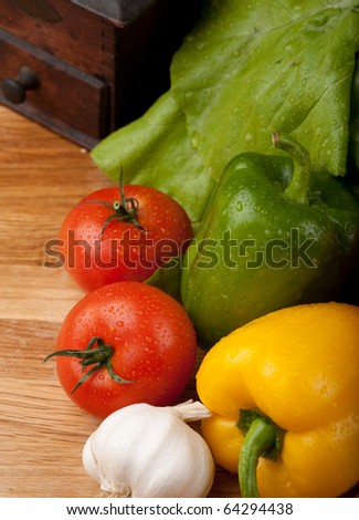 high angle view of vegetables and pepper grinder - stock photo