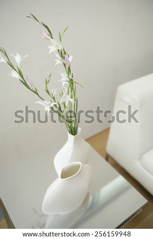 High angle view of white lilies in a flower vase