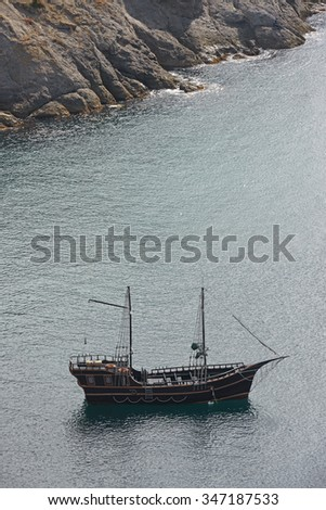 High angle view of yacht on rippled surface of sea water background.
