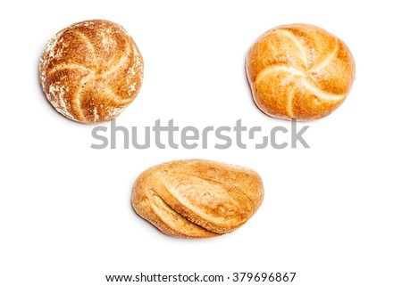 High angle view on three different bread rolls on white background, cutout isolated.