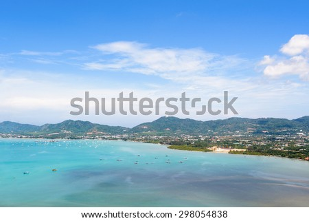 High angle view sea sky and seaside tourist town of Ao Chalong bay from Khao-Khad mountain viewpoint famous attractions in Phuket island, Thailand - stock photo