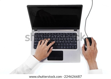 High angle view table of businessperson hands using laptop computer and mouse