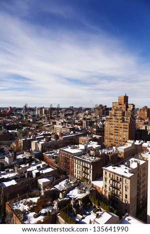 High angle view to the west at the snow covered rooftops of the West Village in Manhattan, on a lovely sunny day.