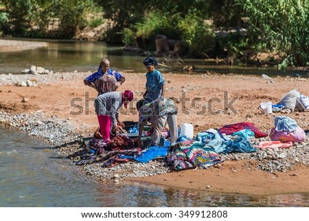 High Atlas, Morocco - September 19, 2015 - women washing laundry in a river