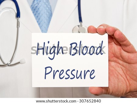 High Blood Pressure - Hypertension - Doctor with sign and text - stock photo
