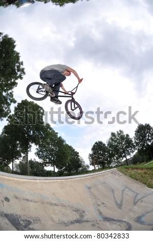 High BMX jump in a skate park - stock photo