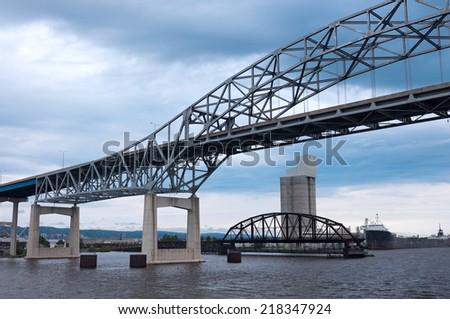 High bridge and old interstate bridge spanning Lake Superior in Duluth Minnesota - stock photo
