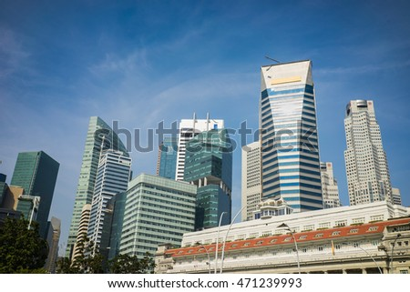 High buildings in Singapore on blue sky background