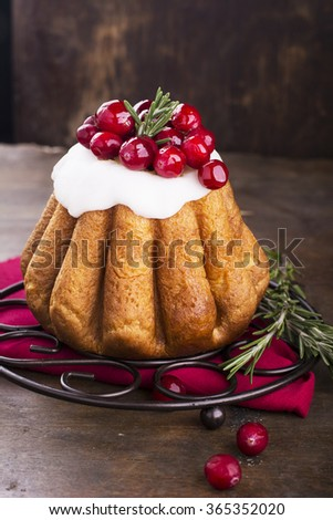 High cake cupcake with white icing and fresh juicy cranberries on a dark wooden background with bright red cloth. selective Focus - stock photo