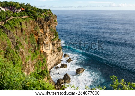 High Cliff at Uluwatu Temple, Bali, Indonesia - A scenic Uluwatu Cliff with pavilion and blue sea in Bali Indonesia. - stock photo
