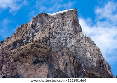 High cliff on the background of clouds in the Caucasus