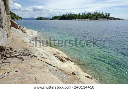 High cliff on the shore of Superior Lake - stock photo
