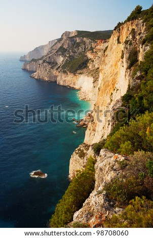 High Cliffs by the sea in setting sun - stock photo