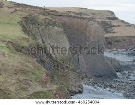 High Cliffs on Blegberry Beach on the Atlantic Coast at Low Tide on the South West Coast Path between Clovelly and Hartland Quay, Devon, England, UK. - stock photo