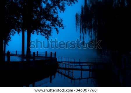 High contrast, Beijing deserted lake at nightfall. - stock photo