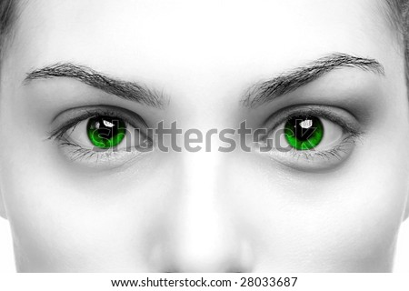 High contrast black & white close up of a womans eyes coloured green