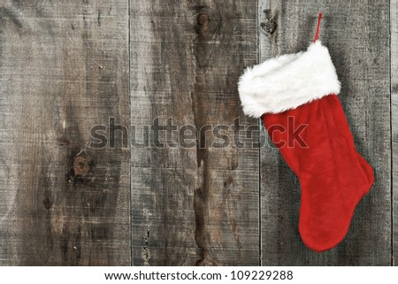 High contrast grunge Christmas sock on wood - stock photo