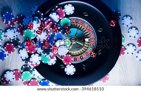 high contrast image of casino roulette and playing chips - stock photo