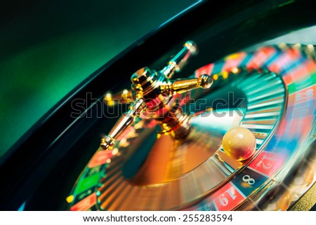 high contrast image of casino roulette in motion / selective focus on ball - stock photo