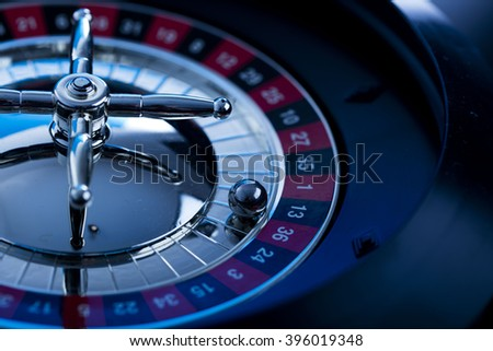 high contrast image of casino roulette, playing chips and dice - stock photo