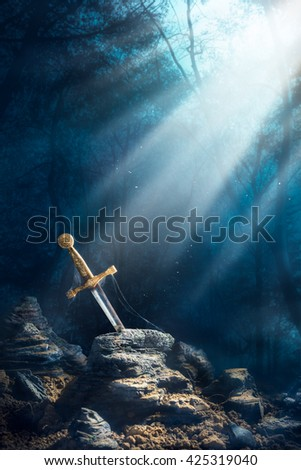 High contrast image of Excalibur, sword in the stone with light rays and dust specs in a dark forest - stock photo