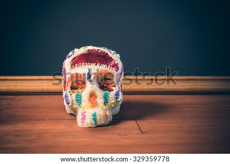 "High contrast image of sugar skull used for ""dia de los muertos"" celebration in a grey background - stock photo"