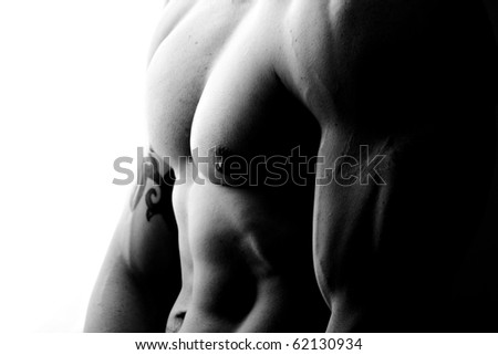 high contrast side view in black and white of muscular male chest