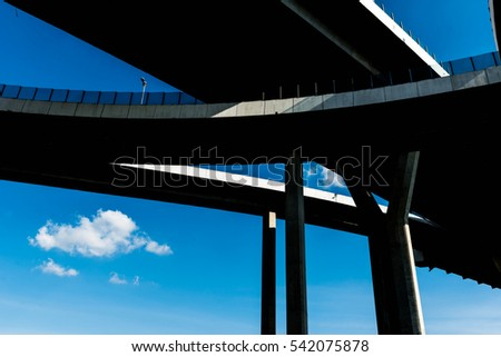 High contrast silhouette of highway ramps on a sunny day, useful for construction, engineering, transportation, building, industrial concepts