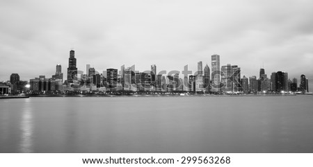 High contrast sunrise lights the long downtown Chicago skyline traditional black and white