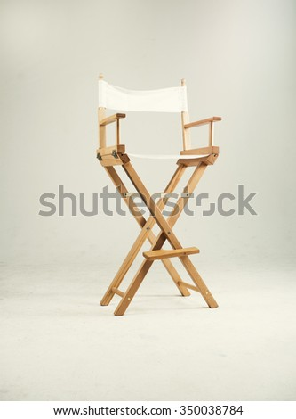 High director chair bar stool on white background. Shallow focus. Studio.
