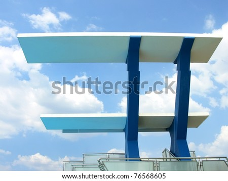 High diving board at a public swimming pool.