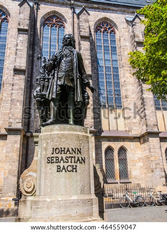 High dynamic range HDR The Neues Bach Denkmal meaning new Bach monument stands since 1908 in front of the St Thomas Kirche church where Johann Sebastian Bach is buried in Leipzig Germany