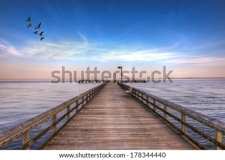 High Dynamic Range image of a Fishing pier on the Eastern shore of the Chesapeake Bay in Maryland - stock photo