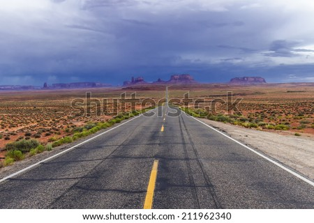High Dynamic Range Image of a road leading to Monument Valley at dusk.