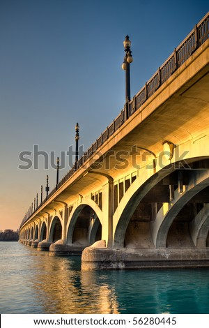 High dynamic range image of the MacArthur Bridge (once known as the Belle Isle Bridge) at sunset over the Detroit River in Detroit, Michigan.