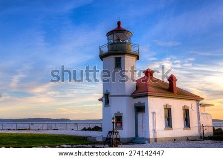 High Dynamic Range view of sunset over Alki Point Light in Alki Beach, West Seattle, WA, US