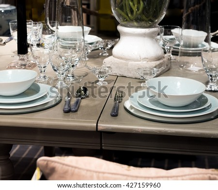 High-End Table Setting with Fine Cutlery, Glassware and Crockery - stock photo