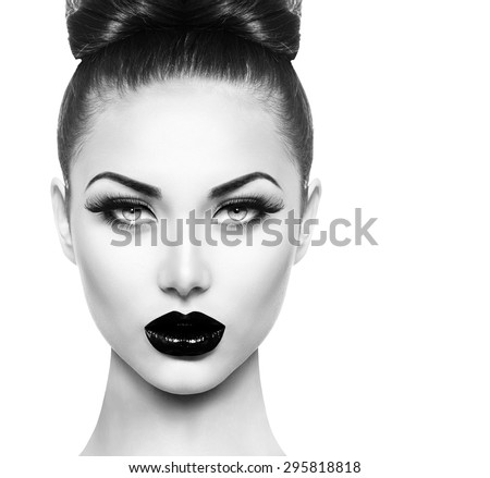 High Fashion Beauty Model Girl face close up with Black Make up and Long Lushes. Black Lips. Dark Lipstick and White Skin. Vogue Style Portrait isolated on white background - stock photo