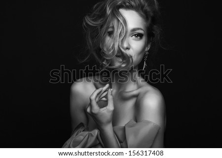 High fashion. Emotional portrait of a beautiful sexy blonde with long hair and bright make-up - stock photo