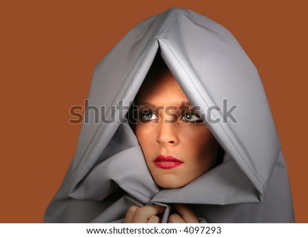 High Fashion Glamour Image of a Woman on Salmon Orange Contrasting Dramatic Background - stock photo
